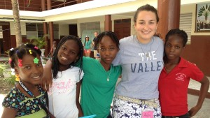 Education major Abby Leidigh poses with children from Haiti